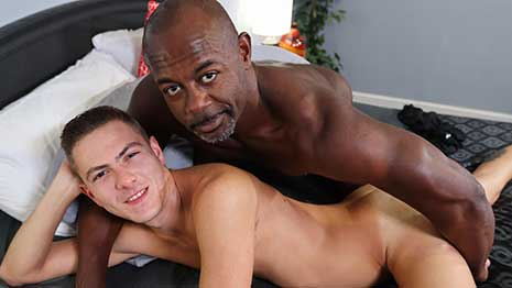 Aaron Trainer is stroking his big dick and gets surprised by Johnny Hunter who hungrily swallows it whole. Johnny's talented mouth drives Aaron crazy until he cannot take it and rims Johnny's asshole before drilling his ass with great enthusiasm.