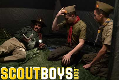 Young scouts Austin and Jack finish their evening chores and join Scoutmaster Cox in their tent. Tired from a full day adventuring out in the woods, and spending time with the other boys at camp...