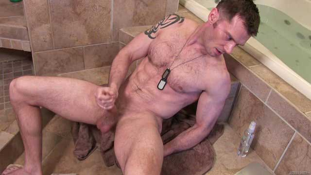 James Drake is one strapping soldier. This thirty-nine-year-old stud shows off his jacked body before jacking his big dick for the camera in this sexy solo.